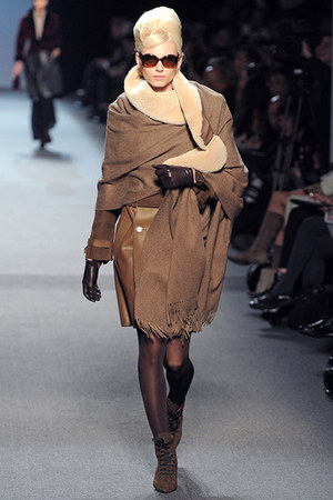 lace up boots - trench coat - sunglasses - cape - leather gloves - stockings