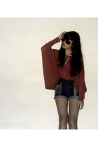 brick red top - high-waisted Editors Market shorts - aviator sunglasses