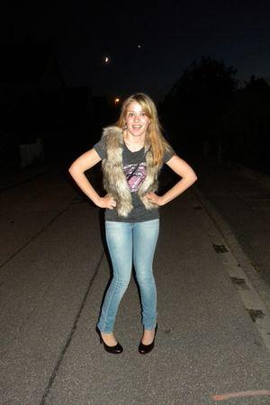 blue jeans - gold shoes - gray t-shirt - brown vest