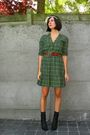 Green-dress-black-boots-brown-belt-black-socks-white-headband-accessorie