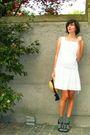 White-dress-gray-socks-black-shoes-yellow-hat-gray-cardigan