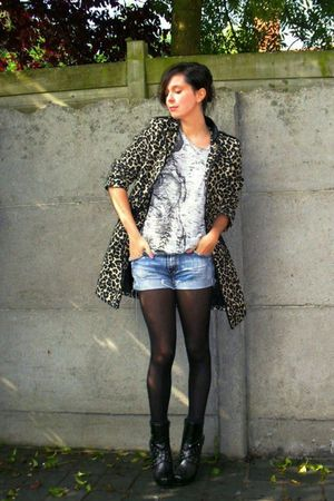 brown coat - silver top - blue shorts - black boots