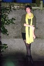 Green-sweater-black-skirt-black-boots-yellow-scarf