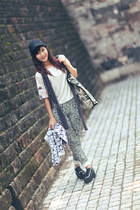 black clogs - dark gray hat - white t-shirt - heather gray pattern pants