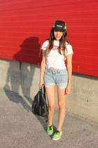 black Supreme hat - red Supreme shirt - black bag - sky blue Levis shorts