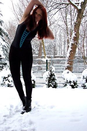 black boots - black swimwear - black leggings