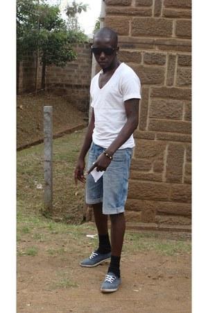 black socks - blue denim shorts - shambala bling bracelet - black glasses
