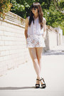 White-floral-shorts-sky-blue-two-toned-blouse-black-heels