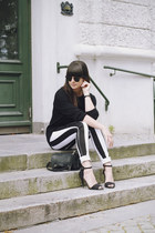 white striped jeans - black sweater - black heels