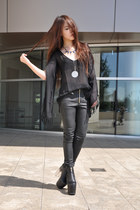 black UNIF boots - black UNIF pants - child of wild necklace