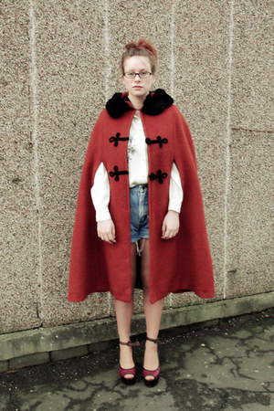 blue shorts - brick red cape - burnt orange cape