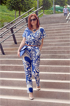 Blue printed jumpsuit and nude stilettos