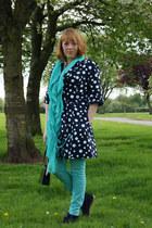 cream coat - turquoise blue jeans - black bag