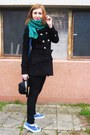 Black-coat-black-hat-green-scarf-blue-bag-black-pants-blue-sneakers