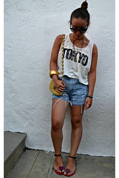mustard Miu Miu bag - blue Levis shorts - black ray-ban sunglasses