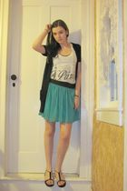 green skirt - white top - black shoes
