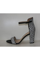 black strappy black and white sandals