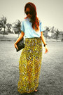 Black-clutch-bag-skirt-aquamarine-top-black-clogs