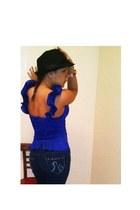 blue top - navy jeans - black hat - red bracelet