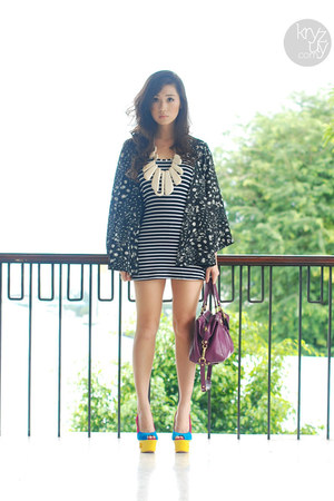 white island girl necklace - black WAGW dress - purple coach bag