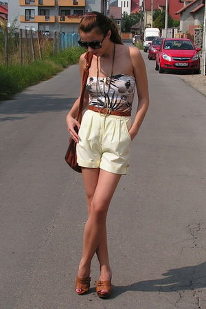 beige top - yellow shorts - brown belt - brown purse - brown shoes - black sungl