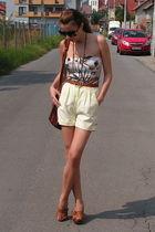beige top - yellow shorts - brown belt - brown purse - brown shoes - black sungl