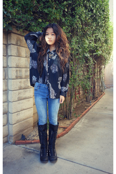 black printed blouse - black lace up boots - sky blue denim jeans