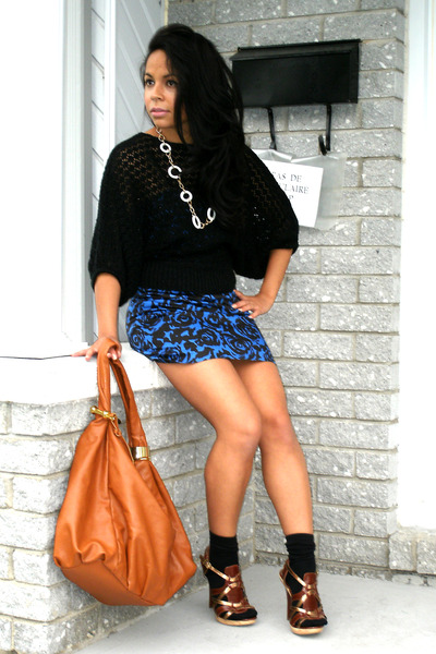 brown bags blue dresses brown shoes black sweaters