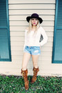 burnt orange Minnetonka boots - black hat - sky blue shorts
