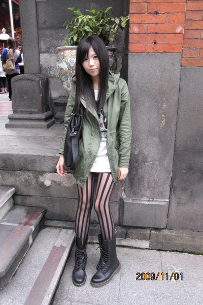 green coat - black Dr Martens boots - white dress