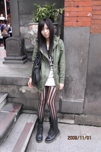 green coat - black Dr Martens boots - white dress
