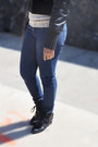 Black-jacket-navy-jeans-tan-sweater-black-sneakers