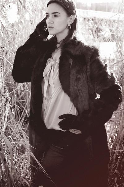 black boots - dark brown pony fur coat - black jeans - silver blouse