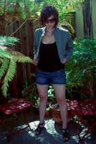 green jacket - black top - blue shorts - black shoes - silver necklace - brown c