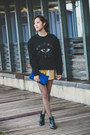 Black-zara-boots-blue-clutch-saint-laurent-bag-gold-gold-color-a-land-shorts
