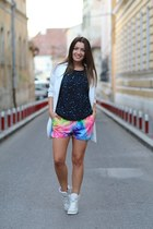 Colored shorts and sequinned blouse