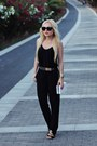 Black-shoes-white-bag-gold-watch-gold-belt-black-top-black-pants
