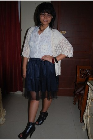 white shirt - dark brown bracelet - ivory cardigan - black glasses - navy skirt