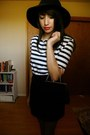 Felt-hat-hat-striped-shirt-tights-clutch-bag-skirt