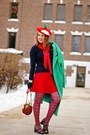 Green-wool-coat-red-apple-hat-navy-cashmere-sweater-red-tartan-tights