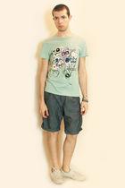 blue from london t-shirt - blue Zara shorts - white H&M shoes - H&MTopman bracel