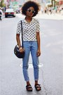 Light-blue-vintage-thrifted-jeans-black-city-coach-bag