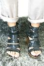 Black-top-gray-vest-beige-pants-black-shoes