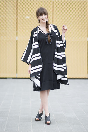 black H&M cape - black Clarks heels