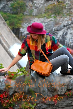 Red-shirt-orange-purse-gray-pants-red-hat