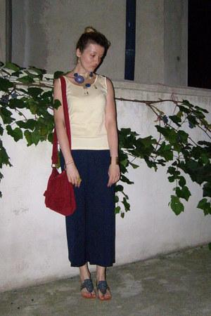 gold wide banyan bracelet - ruby red meli melo bag - navy paula soler flats