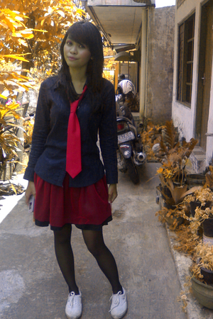 black shirt - red tie - red skirt - black stockings - white shoes