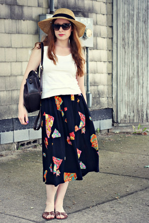 hat - backpack bag - white tank top - printed skirt
