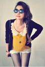 Mustard-shirt-off-white-shorts-black-cardigan