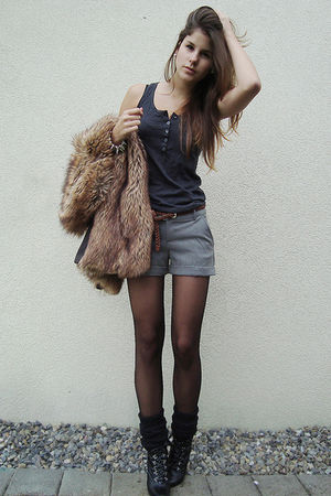 black boots - black tights - black socks - gray shorts - green top - brown vest